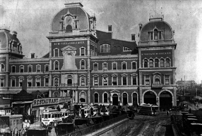 Grand Central Station with streetcar in front of the building.